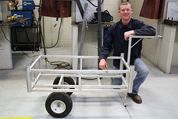Welding Technology student with hand made wagon.