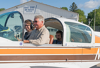 Instructor and students in airplane